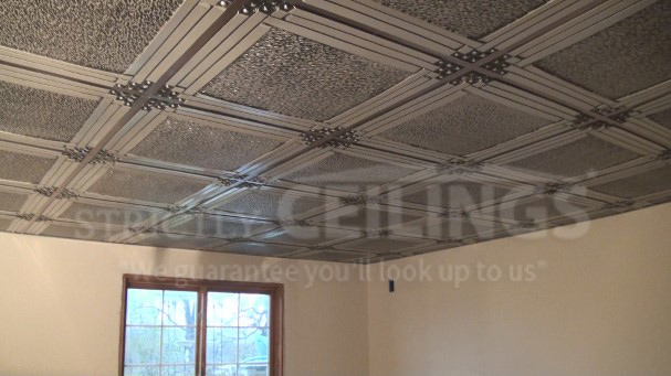 some drop ceiling grids have a track system that mounts directly to the floor joists these systems are made out of vinyl plastic but are only useful if you